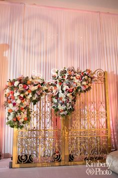 Suhaag Garden, Indian Wedding Decorators, Sophisticated Reception Decor, Coral, Rose & Gold, Coral, Pink & White Flowers, Foliage, Reception Stage, Ornamental Gates, Pipe and Drape, Fabric Wall Treatments