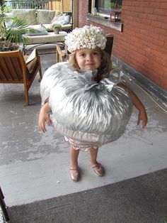 DIY jiffy pop costume!! hee hee!  Would be even cuter with a silver handle on one side. Could spray paint a coat hanger silver and bend it to size, clipping off the excess!   :)  Could also make this with foil, using foam underneath to give poof and comfort.  :)