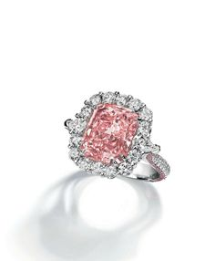 An important 7.07 carats fancy intense pink cut-cornered rectangular Type IIa diamond ring