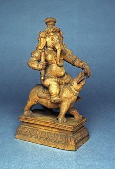 Figure (Ganesa). On his rat. Made of wood.