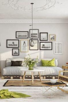 decoração sala de estar em branco preto e verde, gallery wall, muitos quadros na parede em preto e branco