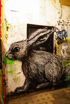 There is another pin of this with the door open. rabbit street art. 000