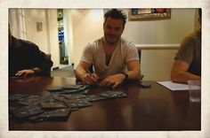 Andrew from Civil Twilight, hard at work signing booklets!