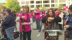 A group with Notions Marketing attempted the record for arm knitting at Rosa Parks Circle on Friday.