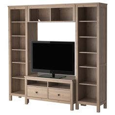 HEMNES TV storage combination - IKEA.  Add a little molding and it would fit in my den.