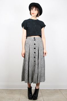 This outfit has styles shown from the 1990s. This skirts length and fullness, the shirts length, and the platform shoes were all loved in the 1990s. 3/26/2015