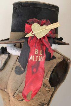 vintage hat upcycled on dress form...........