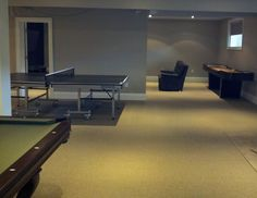 A complete room.  A Brunswick smash 7.0 table tennis with a Brunswick pool table and a shuffleboard.  Who could not have fun in this room