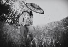 Gorgeous couple posing for a classic black and white shot with umbrella