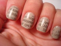 Paint nails in a light color.  Let nails dry completely (this is very important).  Layer a piece of newspaper over the nail.  Press a cotton ball dipped in rubbing alcohol over the newsprint so the text transfers to the nail. Hold a few seconds.  Lift the newspaper from nail. Let dry.  Finish with a topcoat.