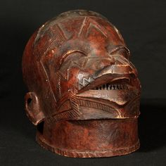 """Makonde Mask, Tanzania,  Lipico helmet mask; red ochre; with scarifications, 10"""" / 25.4cm : Collected by Jean Pierre Hallet"""