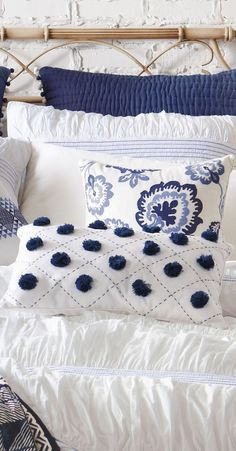 navy blue and white bedroom pillows