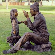 """Grandpa Storyteller"" is one of several life-size bronze sculptures by Victor Issa"