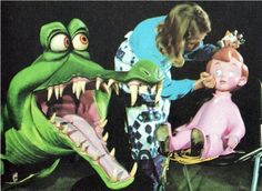 vintage disney - artists add details to the crocodile and michael characters in the 'peter pan's flight' attraction in disneyland