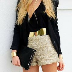 gold belt, sparkly shorts + black top.