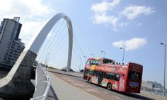 A tour bus crosses the Cyde Arc, west of Glasgow city centre