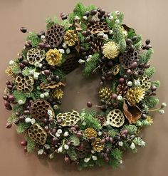 Natural bespoke designer Christmas wreaths by Phillo Flowers in London. Pine cones and leaves, dried poppy heads and dried citrus for this fragrant wreath
