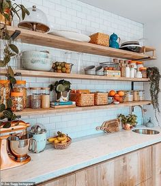 The kitchen is equally stylish, boasting white marble worktops a white brick wall and open wooden shelves of neatly organised condiments Brick Wall Kitchen, Kitchen Wall Shelves, Wooden Kitchen, New Kitchen, Kitchen Interior, Kitchen Decor, Kitchen Design, Kitchen Ideas, Sauce Barbecue