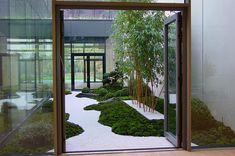 Zengarten im Innenhof eines Neubaus in Hannover - Oase der Stille
