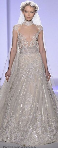 Zuhair Murad Haute Couture Wedding Gown 2013..this is so Stunning..Cinderella Gown! okay so obviously it takes a pretty specific type of body to pull this look off, but I still like the look of these fabrics. They could be made into a more real person flattering pattern.