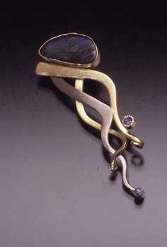 "Joan Tenenbaum   Braided Rivers Brooch II. 1      14kt Gold, 18kt Gold, Boulder Opal, Tanzanites, Diamond .02 tw   2.2"" h x .8"" w x .4"" d"