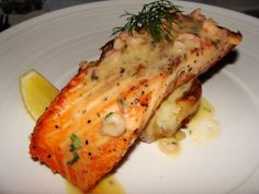 Salmon Filets in a Creamy Garlic-Dijon Sauce - Pan seared salmon with creamy garlic Dijon sauce, bathed in diced shallots, white cooking wine, seasonings, garlic, and Dijon mustard. Turn people onto seafood with this amazingly smooth and rich, yet light and delicate salmon dish.
