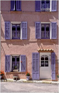 Darling, I had the house in Provence painted Pink and had the shutters done in lavender to go with our lavender fields. Mode Poster, Ville France, Provence France, French Countryside, South Of France, Shades Of Purple, Periwinkle Blue, Windows And Doors, Beautiful Places