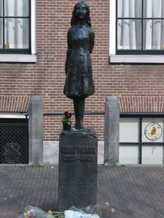 This bronze sculpture of Anne Frank stands on the Westermarkt in Amsterdam near the Anne Frank House. It was created by Mari S. Andriessen, and unveiled in 1977. The sculpture reminds passers-by of Anne Frank and the Second World War.