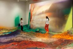 Vistors walk through Wunderblock | colorful acrylic paint on soil, walls, ceiling, and canvas