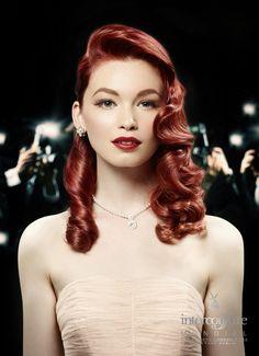 Red hair long wavy retro hair style.