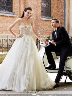 Sophia Tolli - Strapless shimmer tulle ball gown with deep sweetheart neckline featuring an illusion panel, hand-beaded lace appliqué bodice, back corset, full finely gathered skirt with chapel train.