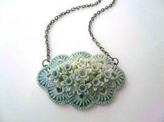 Home › minusOne › n e c k l a c e  Pastel Necklace. Blue and ivory sideways filigree flower on dark brass chain.
