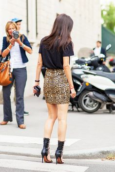 Black tee tucked into animal print mini pencil skirt with strappy heels. // #StreetStyle