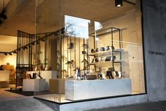 The fixture system was designed to be more a collection of furniture, featuring hand crafted brass and timber tables, shelving units with slabs of cement and monolithic plinths combining with leather screens to create multiple merchandising opportunities and a journey for the customer to discover the various ranges within the seasonal collection.