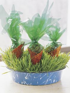 How-to: Brush a mix of red and yellow food coloring on waffle cones. Let dry on waxed paper. Fill green cellophane with jelly beans, tie with raffia, and plant cones in a shallow container of wheatgrass.  - GoodHousekeeping.com