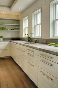 clean lines, but warm - white cabs with warm grey countertop/ would use more modern cabs.  there are ways to add color and texture so it doesn't feel sterile (shelves, tile, countertop)