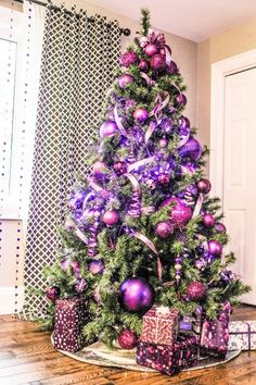 a non traditional colour like purple the biggest trend this season marries well with silver and gold - Purple And Gold Christmas Tree Decorations
