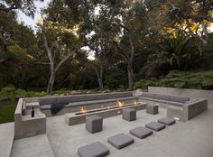 15 Outdoor Conversation Pits Built For Entertaining // This outdoor concrete living space contrasts the lush greenery surrounding it and makes it feel extra modern.