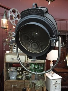 Booth 29 at The Agoura Antique Mart has this awesome movie light turned into a tripod light! It would be great in a movie room!