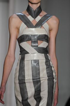 Two tone leather dress with linear pattern structure; bold fashion details // Dion Lee