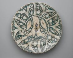 Plate, early 17th century. Ceramic, Kubachi ware; fritware, painted in green, cobalt blue, and black with red and yellow slips under a transparent glaze, 13 3/4 x 2 5/8 in. (35 x 6.6 cm). Brooklyn Museum, Gift of Mrs. Horace Havemeyer, 42.212.38. Creative Commons-BY (Photo: Brooklyn Museum, 42.212.38_top_PS2.jpg)