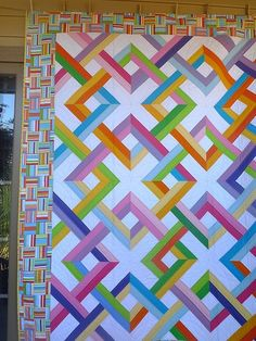 One very cool quilt. The split rail fence border is great. Colorful and cheery.
