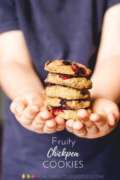 Child holding a stack of chick pea cookies