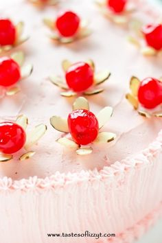 "Light, airy from-scratch maraschino cherry cakes with pink almond and cherry flavored buttercream. Top this cherry almond cake with simple little ""flowers"" made from almonds and cherries."