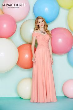 Ronald Joyce Long Coral Bridesmaid Dress with off the shoulder neckline ruched bodice and long floor full length skirt.This style can be used for bridal party as maid of honor,or any special occasion event as evening cocktail wear for women.