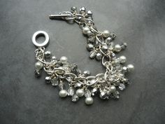 Silver findings, crystal, and pearl.  I really like this!