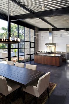 Kitchen & Dining Area of Flyway View House by Jon Anderson Architecture