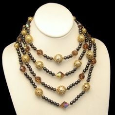 Vintage 4 Multi Strands Necklace Swarovski Topaz AB Crystals Glass Beads Chunky, $249 from http://stores.ebay.com/My-Classic-Jewelry-Shop. Wow! This is a glorious vintage necklace with 4 strands of beads and fabulous topaz colored crystals! :)