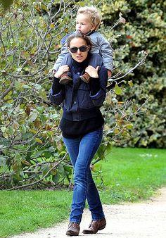 Natalie Portman transported son Aleph, 2, via piggyback ride in the Tuileries Gardens in Paris Oct. 14.