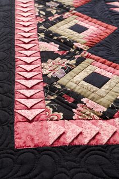 Love rose pink on black! prairie points inserted in sashing